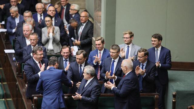 Prime Minister Mateusz Morawiecki congratulates Justice Minister Zbigniew Ziobro who survived a no confidence vote