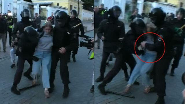 Silny cios w brzuch młodej kobiety. Brutalne zachowanie rosyjskiego policjanta