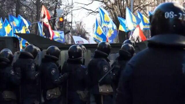 Starcia milicji z demonstrantami